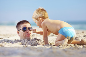Summer time fun for a father and son at the beach